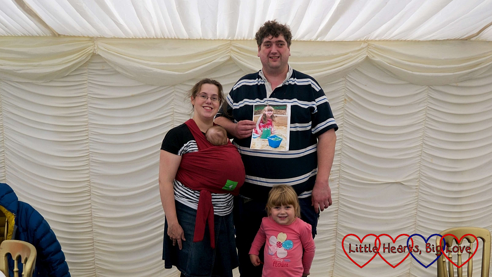 Me, hubby, Sophie and Thomas with a photo of Jessica in the marquee at the Little Hearts Matter memorial event