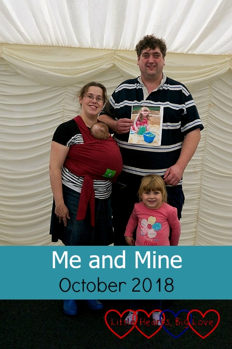 """Me, hubby, Sophie and Thomas with a photo of Jessica in the marquee at the Little Hearts Matter memorial event - """"Me and Mine: October 2018"""""""