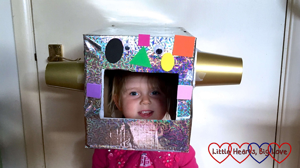 Sophie wearing her finished robot helmet