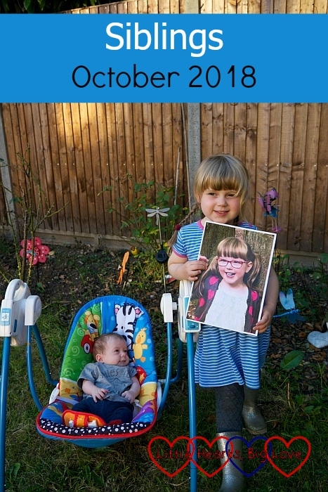 """Sophie and Thomas in the garden with a picture of Jessica - """"Siblings - October 2018"""""""