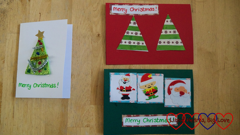 A sparkly craft foam Christmas tree card; a ribbon Christmas tree card and a card with festive stickers on