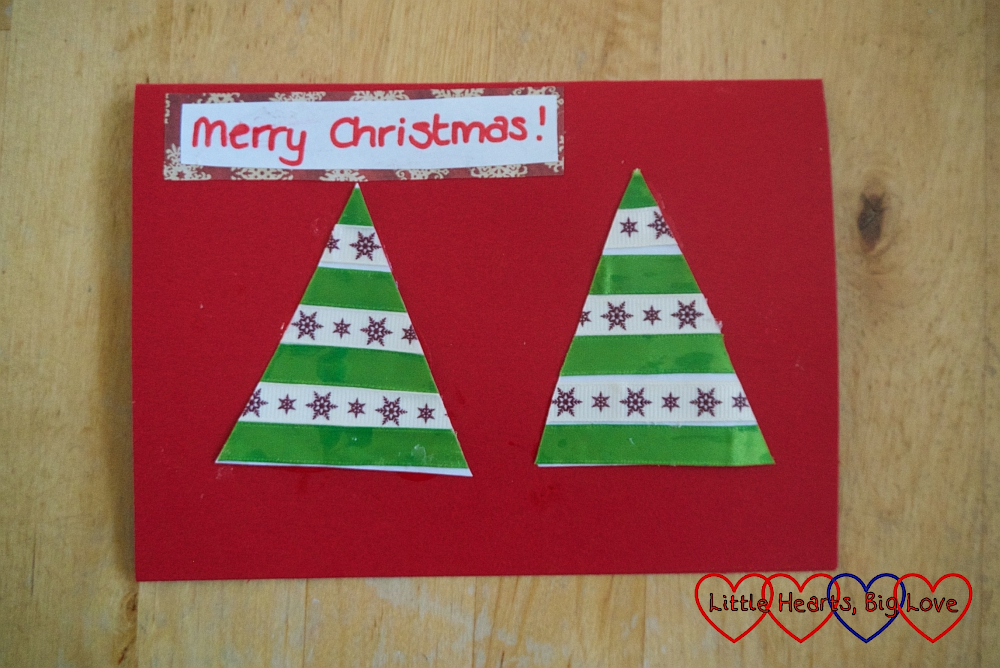 "The finished ribbon card with two triangles with alternating coloured ribbon and ""Merry Christmas"" at the top of the card"