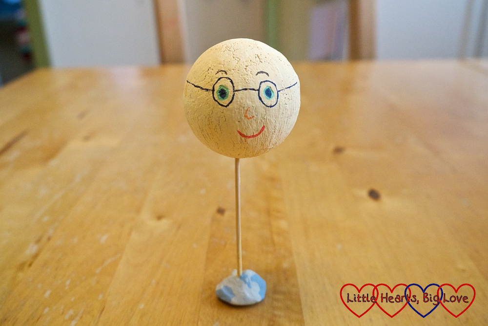 A painted polystyrene ball with a face drawn on it