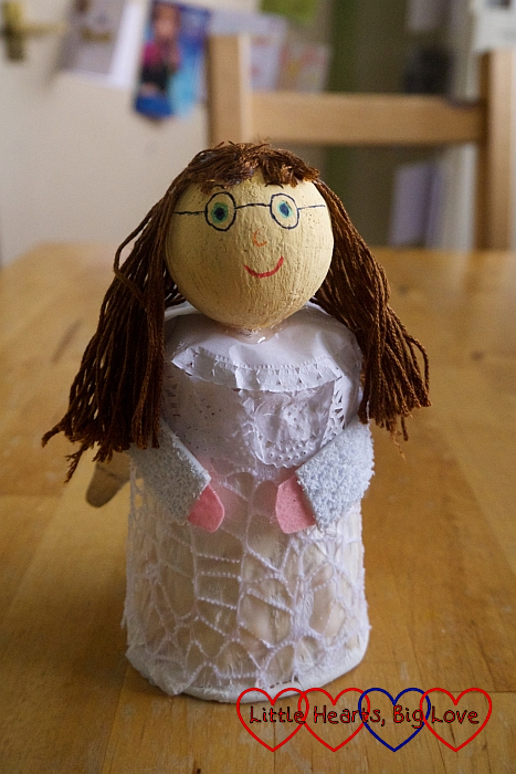 The angel with brown embroidery thread hair