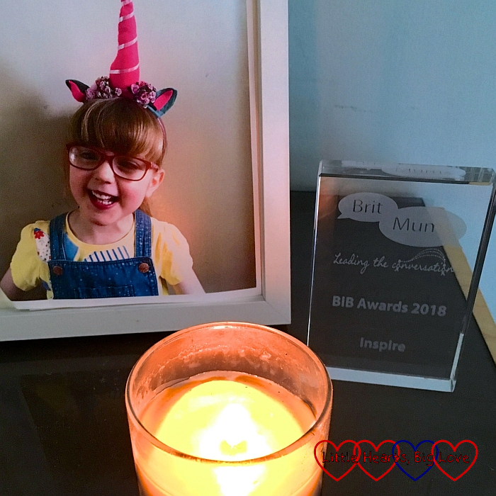 My BiBs award next to a candle and a photo of Jessica