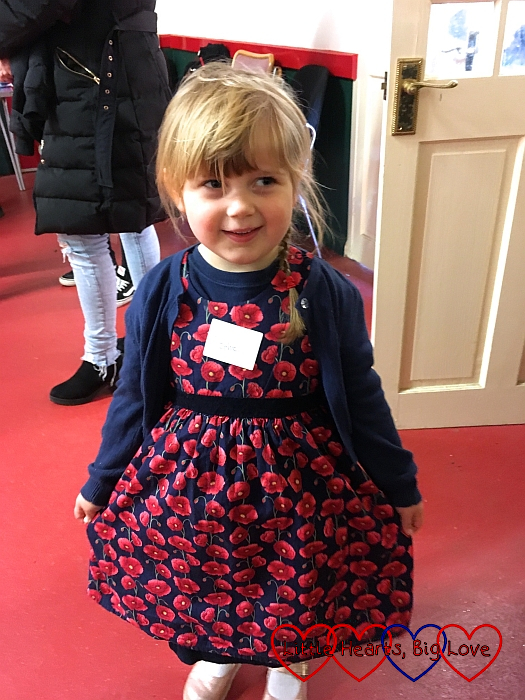 Sophie wearing a poppy print dress