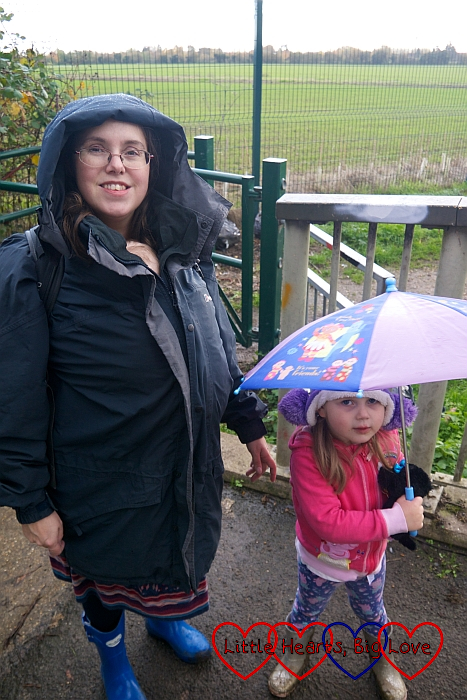 Me with Thomas inside my jacket and Sophie with her umbrella