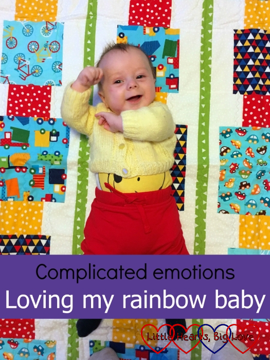 """Thomas lying on a quilt with pictures of cars - """"Complicated emotions: loving my rainbow baby"""""""