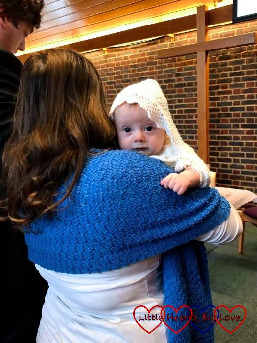Me cuddling Thomas at his christening