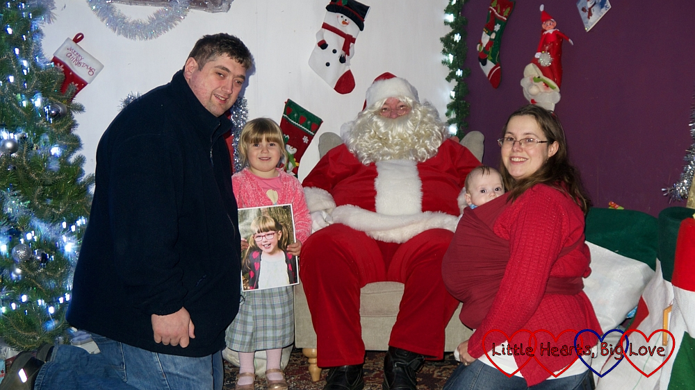 Me, hubby, Sophie (holding a picture of Jessica) and Thomas with Father Christmas at Wyevale World's End