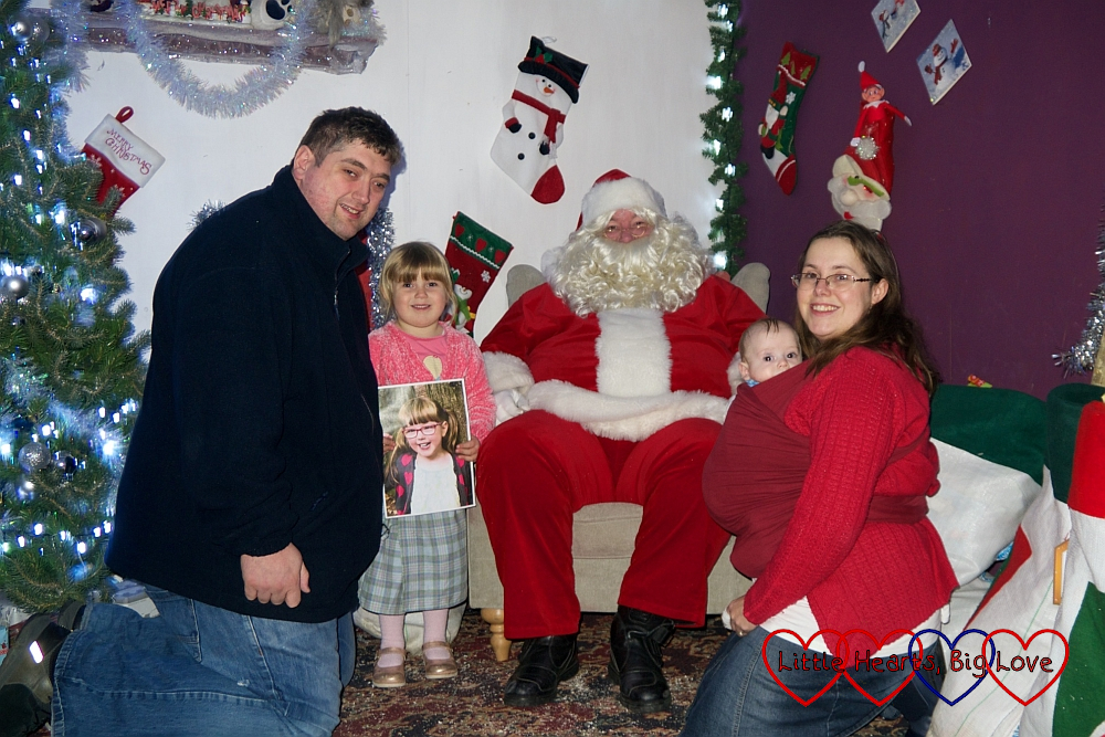 Hubby, Sophie (holding a photo of Jessica), me and Thomas with Father Christmas