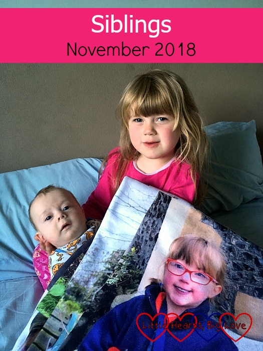 """Sophie cuddling Thomas with Jessica's photo blanket in front of them - """"Siblings - November 2018"""""""