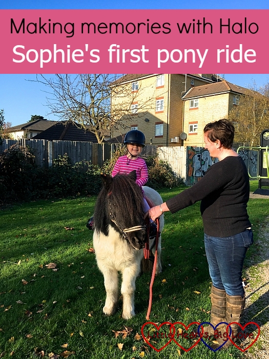 "Sophie riding a brown and white Shetland pony - ""Making memories with Halo - Sophie's first pony ride"""