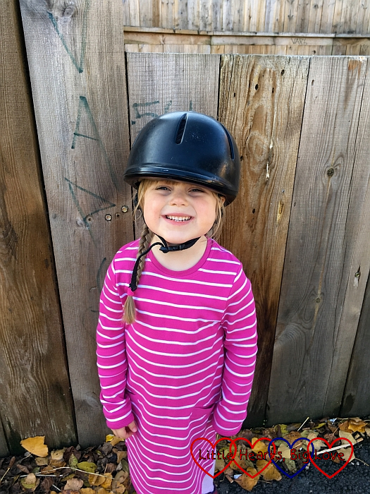 Sophie wearing a hard hat ready for her pony ride