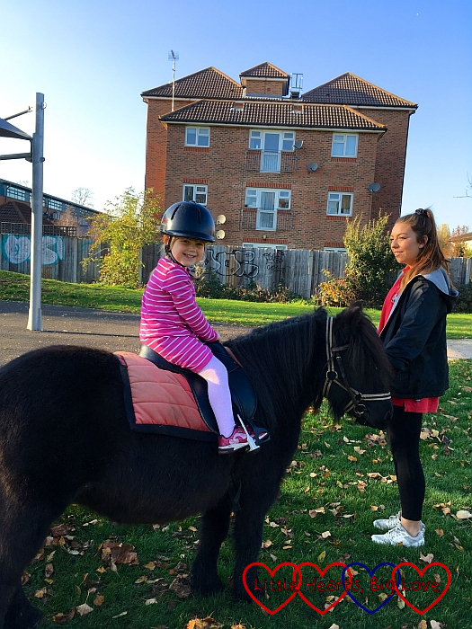 Sophie riding a dark brown pony