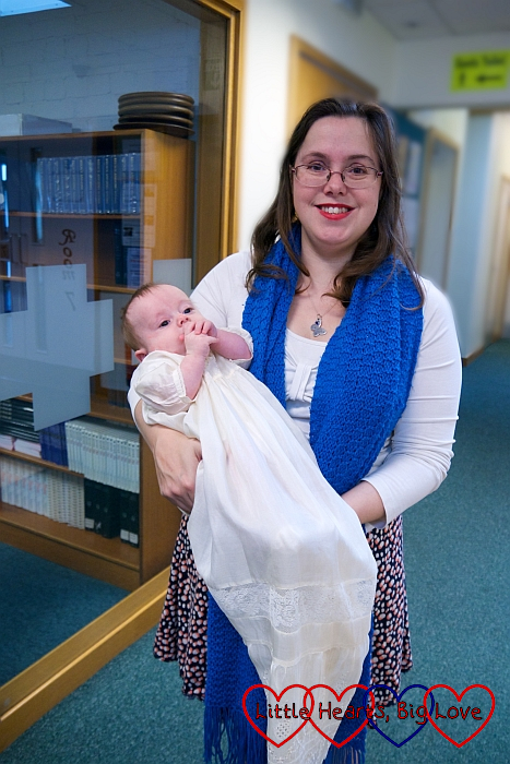 Me holding Thomas in my dad's christening gown