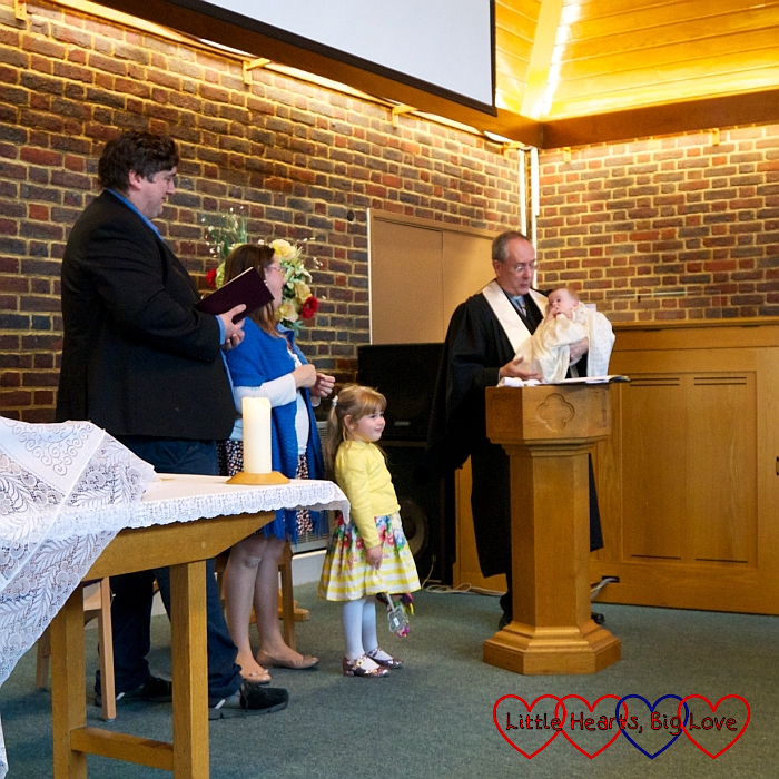 Hubby, me and Sophie looking on as Thomas is baptised