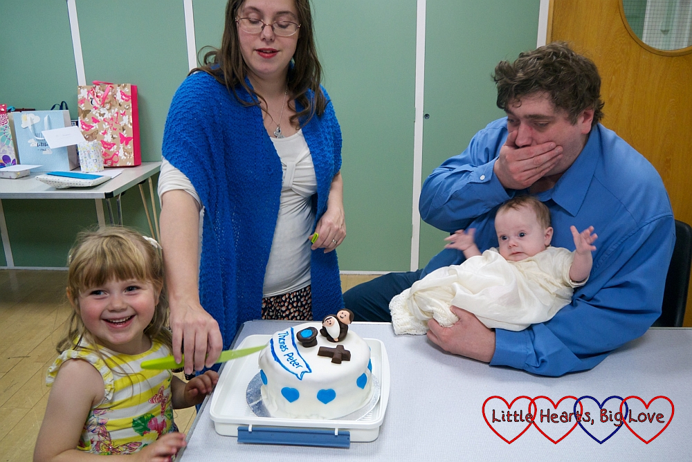 Sophie cutting Thomas's cake with me next to her and hubby holding Thomas