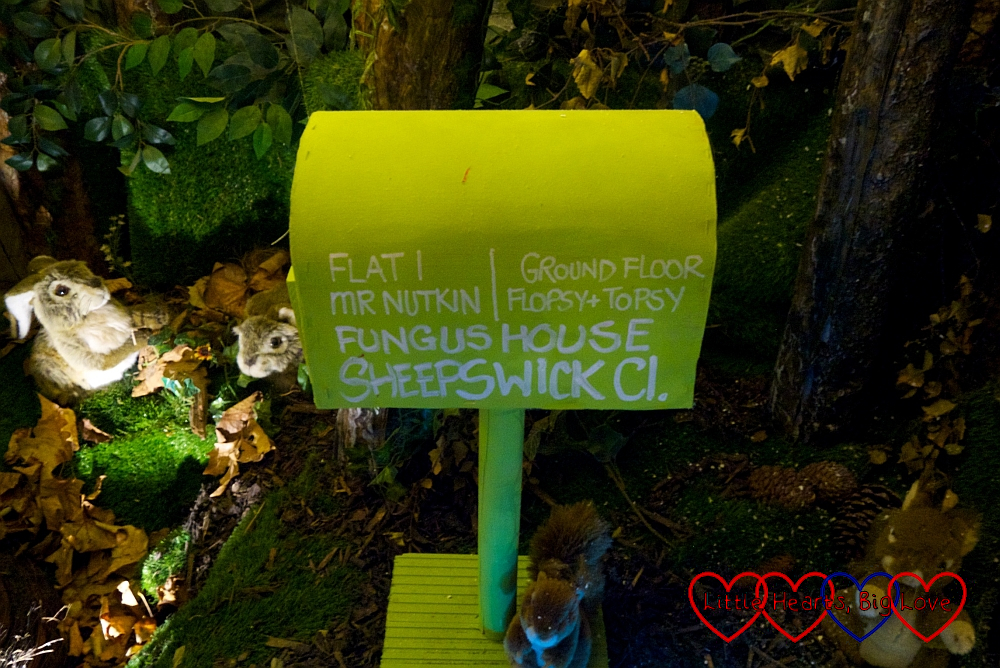 "A green mailbox with ""Flat 1 - Mr Nutkin; Ground Floor - Flopsy & Topsy; Fungus House, Sheepswick Cl."""