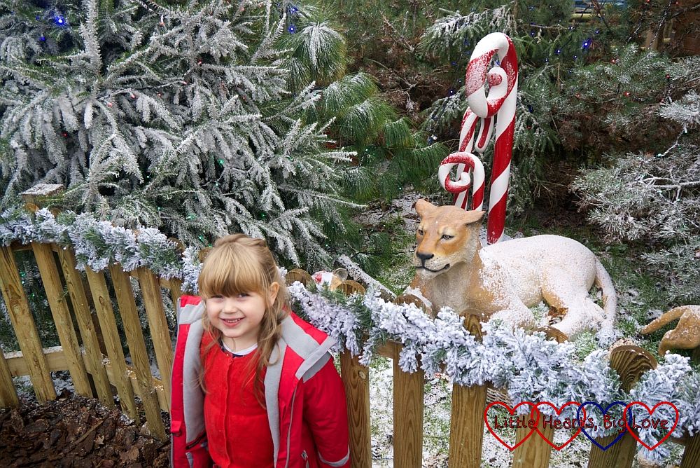 Sophie next to a festive-themed model of a lioness