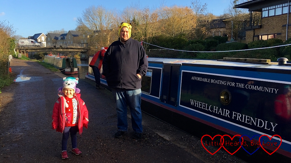 Sophie and hubby on the towpath next to a narrowboat