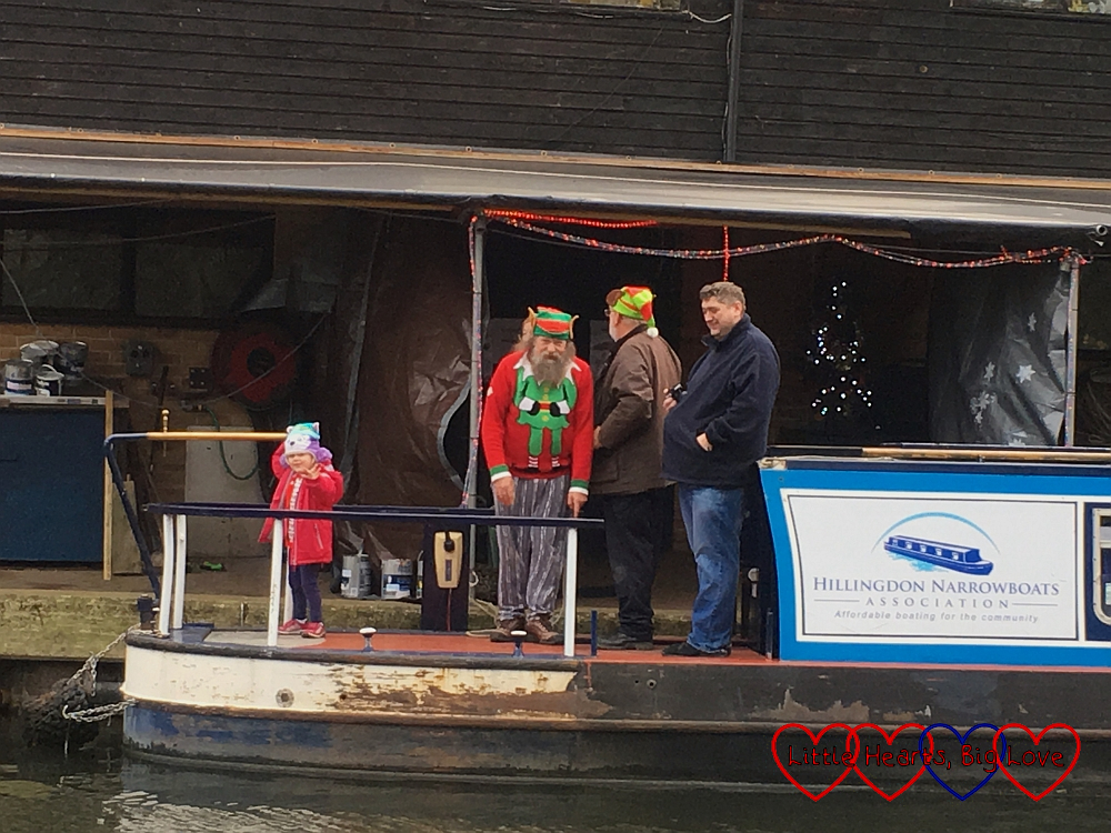 Sophie standing on the boat outside Santa's Grotto