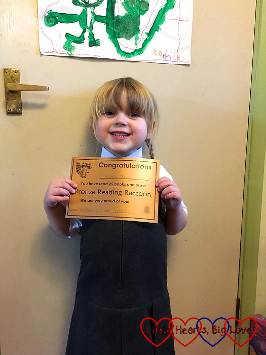 Sophie with her bronze Reading Raccoon certificate