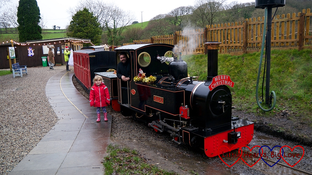 Sophie standing next to the steam train at Lappa Valley Steam Railway