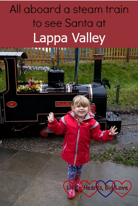 """Sophie standing in front of the steam train at Lappa Valley steam railway - """"All aboard a steam train to see Santa at Lappa Valley"""""""