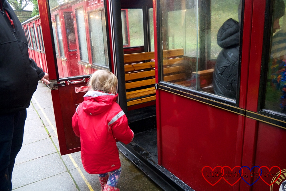 Sophie getting on the steam train