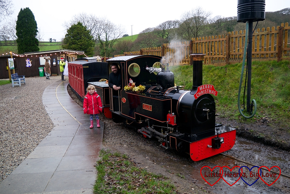 Sophie standing next to the steam train