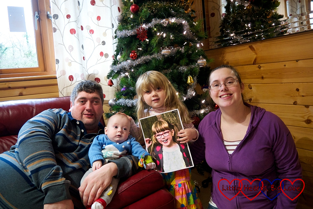 Hubby, Thomas, Sophie (holding Jessica's picture) and me in front of our Christmas tree at Coombe Mill