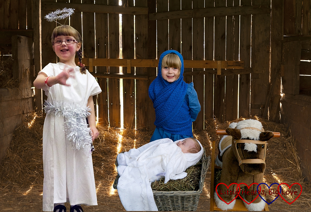 A Nativity scene with Sophie as Mary, Thomas as baby Jesus and Jessica as an angel