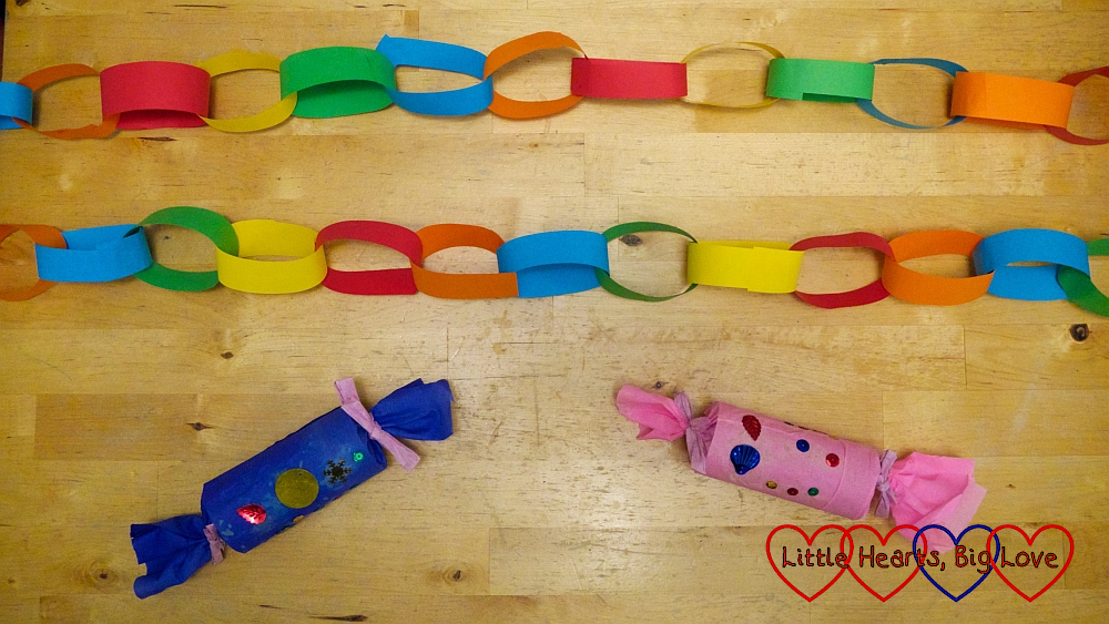 Colourful paper chains and handmade Christmas crackers