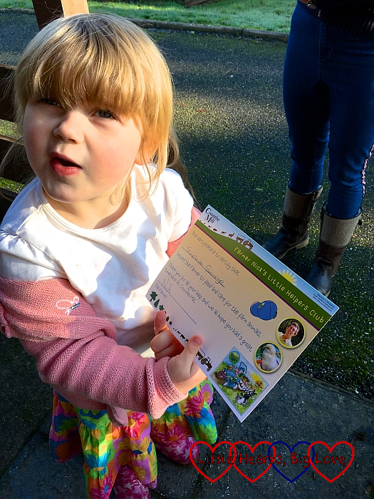 Sophie with her Farmer Nick's Little Helpers Club certificate