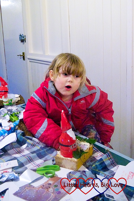 Sophie making her Father Christmas table decoration