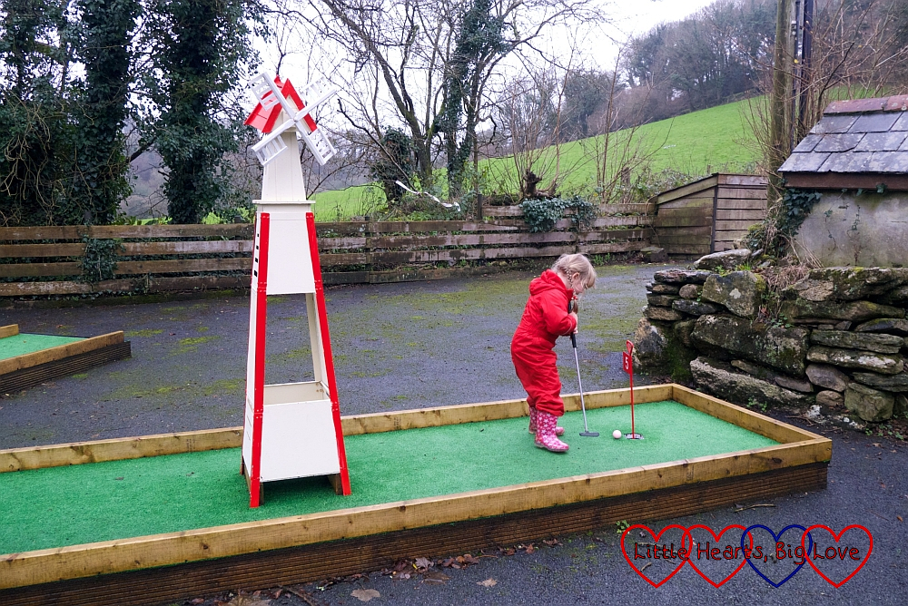 Sophie playing crazy golf