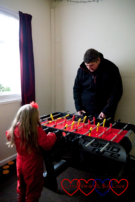Sophie playing table football with Daddy