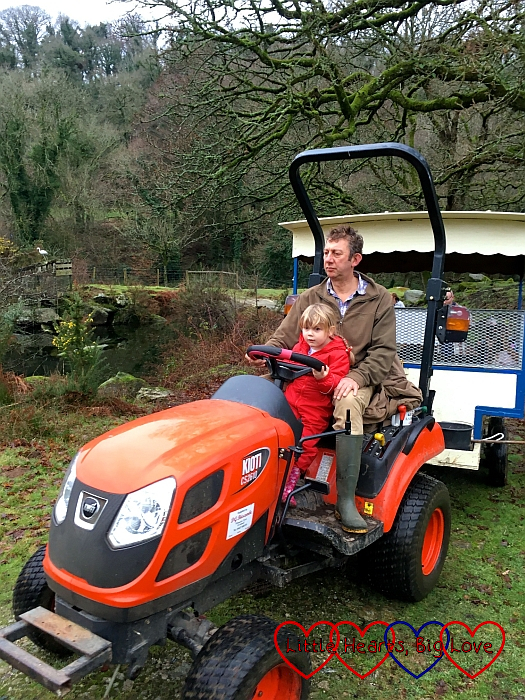 Sophie helping Farmer Nick drive the tractor
