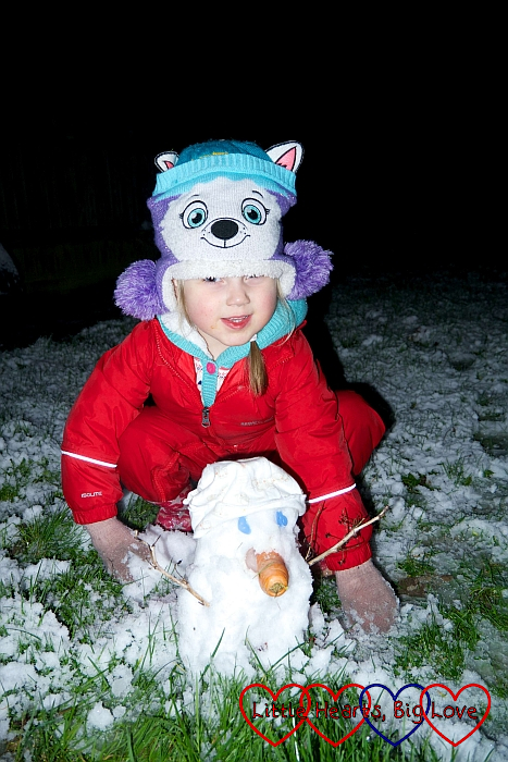 Sophie with her baby snowman