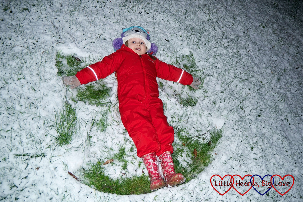 Sophie making snow angels