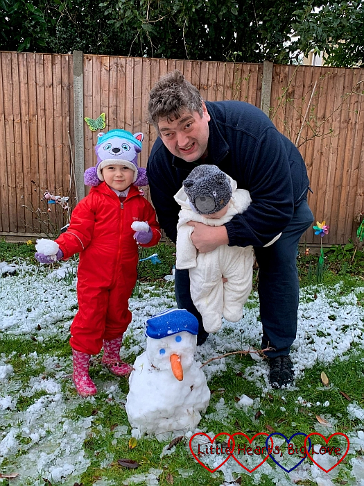 Sophie, Daddy and Thomas next to Sophie's snowman