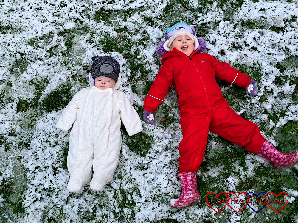 Sophie and Thomas making snow angels