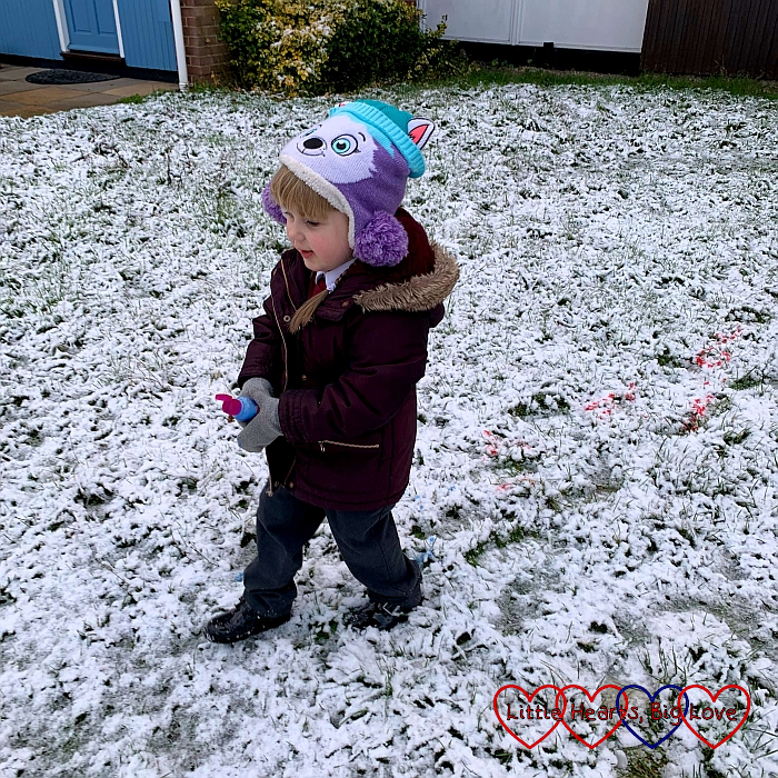 Sophie doing some snow painting with bottles of coloured water