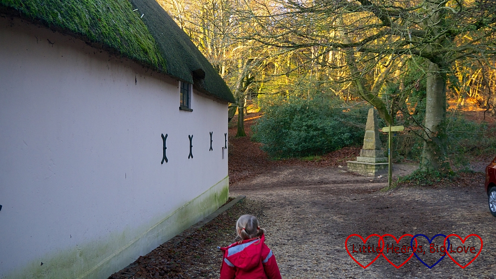 Sophie walking down the lane next to Hardy's Cottage towards the memorial