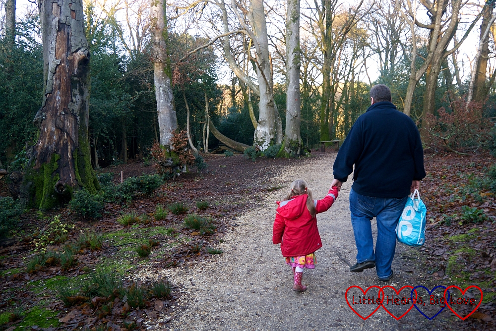 Sophie and Daddy walking through the woods