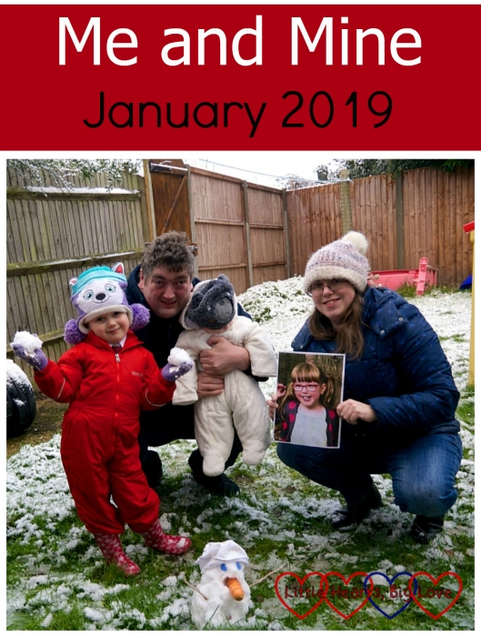 "Sophie, hubby, Thomas and me holding a picture of Jessica next to the snowman Sophie built - ""Me and Mine - January 2019"""