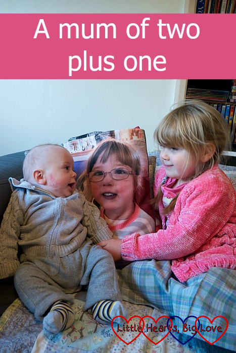 """Sophie and Thomas sitting either side of Jessica's photo blanket - """"A mum of two plus one"""""""