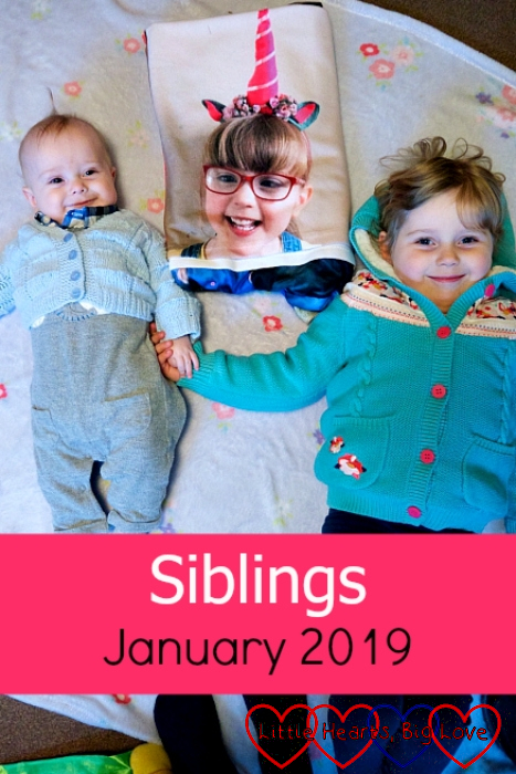 "Thomas and Sophie lying either side of Jessica's photo blanket - ""Siblings - January 2019"""