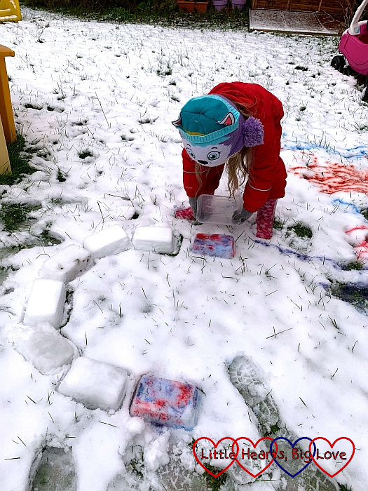 Sophie placing one of the coloured snow bricks